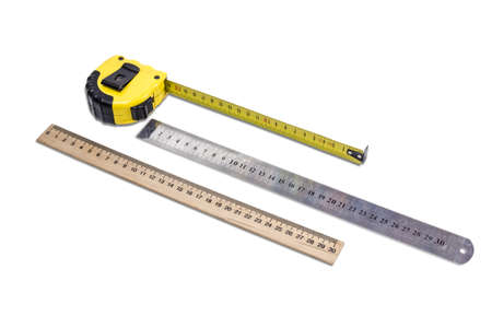 metric: Yellow tape measure, metal ruler and school wooden ruler to measure the dimensions of the metric system on light background.  Isolation.