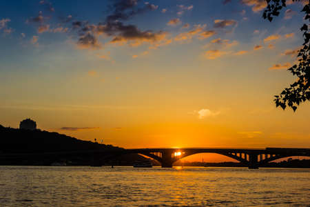 dnieper: Sunset on the Dnieper. View of the bridges and right bank of Dnieper. Kyiv, Ukraine.