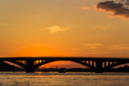 right bank: Sunset on the Dnieper. View of the bridges and right bank of Dnieper. Kyiv, Ukraine.