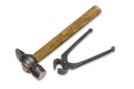 Old hammer and pliers for pulling out nails on a light background. Isolation.