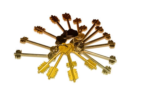 safeness: Great bunch of different keys to door locks located as a fan on a light background. Isolation.