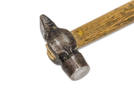 peen: Old metalwork hammer with a wooden handle on a light . Isolation. Stock Photo