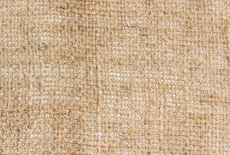 unpainted: Burlap from coarse unpainted spinning fibers from hemp closeup. Texture. Stock Photo