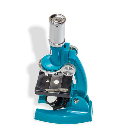 an eyepiece: Specular microscope for schoolboy with a blue hull and bisected the onion, as an object of study on a light background. Isolation.