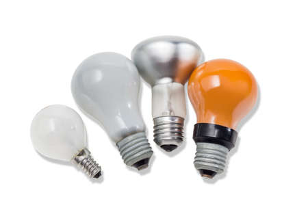specular: Red, two matte electric incandescent lamps different sizes and a lamp with a specular coated of bulb on a light background. Isolation. Stock Photo