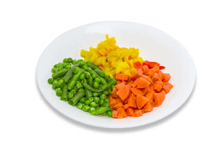 bell peppers: White dish with boiled vegetables  carrots bell peppers green peas green beans on a light background