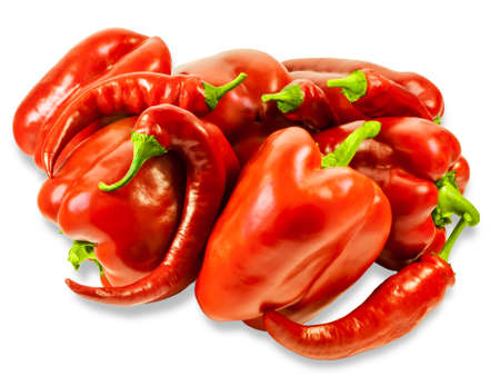 bell peppers: Several fresh red bell peppers and peppers chilly on a light background. Isolation. Stock Photo