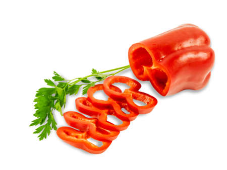 red bell pepper: One fresh red bell pepper part of which is sliced rings and  twig of parsley on a light background. Isolation. Stock Photo
