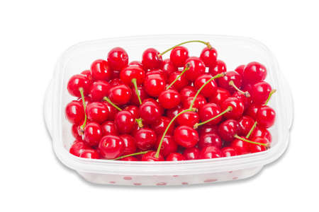 isolation: Transparent plastic tray with ripe cherries on a light background. Isolation.