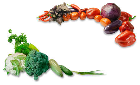 perimeter: Two groups of various fresh vegetables  and herbs laid out around the perimeter of the frame with a free central part on a light background. Isolation.