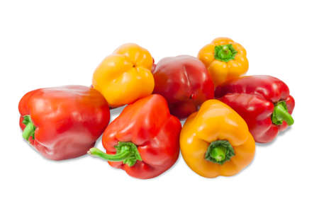 bell peppers: Several fresh red and yellow bell peppers on a light background. Isolation. Stock Photo