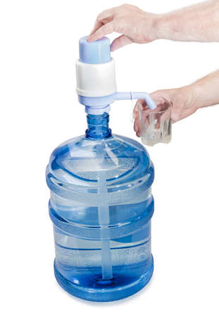 water cooler: Large plastic transparent carboy, capacity 5 gallons (19 liter), with drinking water, installed on it a hand pump with dispenser and a glass in a mans hand. Isolation on a light background. Stock Photo