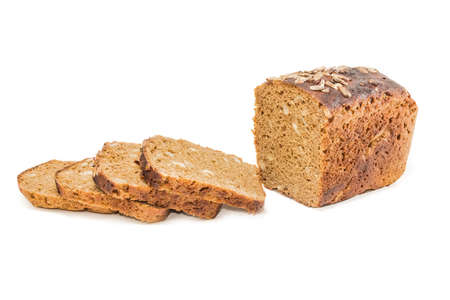 Black bread with whole grain cereals and sunflowers, partly sliced on a light background. Isolation