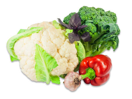 head of cauliflower: One head of fresh cauliflower, one head of fresh broccoli, bell pepper, garlic and twig of basil on a light background. Isolation. Stock Photo