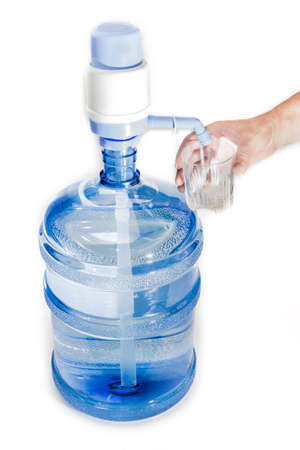 liter: Large plastic transparent carboy, capacity 5 gallons (19 liter), with drinking water, installed on it a hand pump with dispenser and a glass in a mans hand. Isolation on a light background. Stock Photo