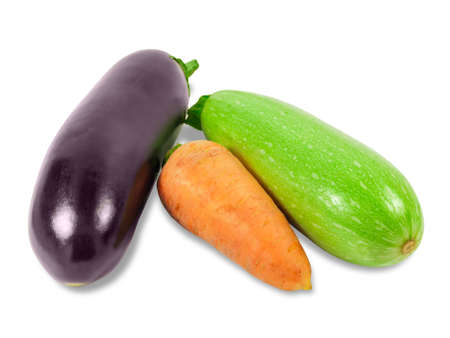 vegetable marrow: Fresh carrot, vegetable marrow and eggplant on a light background. Isolation.