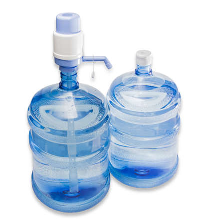 Two large plastic transparent carboys, capacity 5 gallons (19 liter), with drinking water. On one of the bottles set a hand pump with dispenser. Isolation on a light background.