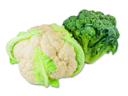 head of cauliflower: One head of fresh cauliflower and one head of fresh broccoli on a light background. Isolation. Stock Photo