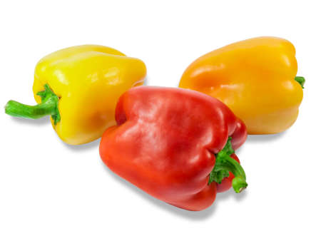 bell peppers: Two yellow and one red fresh bell peppers on a light background. Isolation.