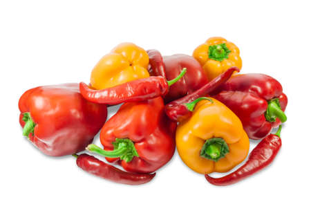 bell peppers: Several fresh red and yellow bell peppers and red peppers chilly on a light background. Isolation.