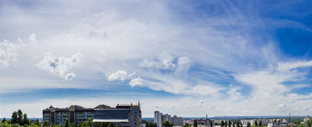 wetness: Sky with cirrus cloud and cumulus humilis cloud against the backdrop of the city summer Stock Photo