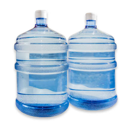 gallons: Two large plastic transparent carboys, capacity 5 gallons (19 liter), for water coolers with drinking water on a light background. Isolation.