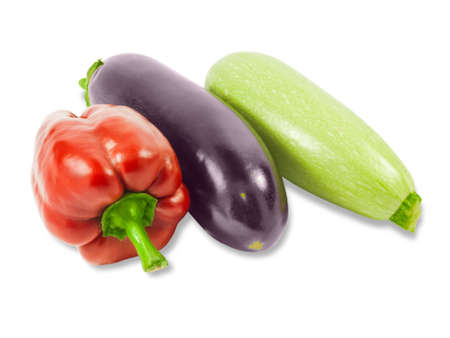 vegetable marrow: Fresh red bell pepper, vegetable marrow and eggplant on a light background. Isolation.