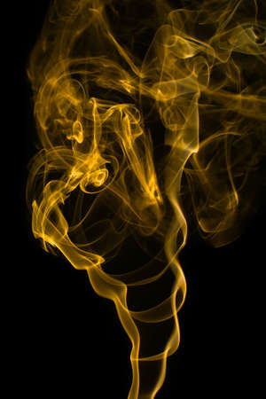 slightly: Abstract yellow smoke isolated on black background. Texture smoke Stock Photo