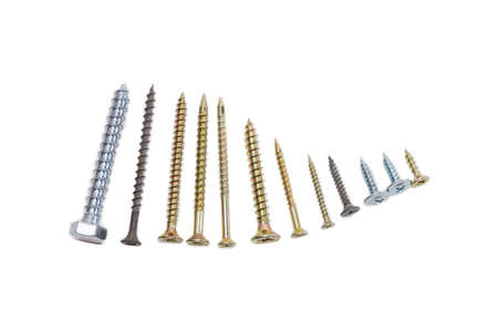 Several wood screws different sizes, shape, design and purpose, covered with a protective anticorrosion coating, on light background. Isolation. 版權商用圖片