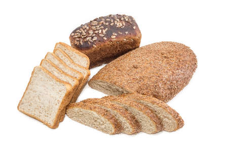 bread: Bread with bran partly sliced, sliced bread for toasting and brown bread with whole grain cereals on a light background. Isolation