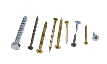 head: Several wood screws different sizes, shape, design and purpose, covered with a protective anticorrosion coating, on light background. Isolation. Stock Photo
