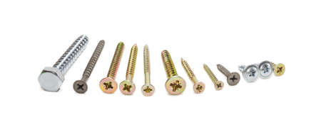 Several wood screws different sizes, shape, design and purpose, covered with a protective anticorrosion coating, on light background. Isolation. 스톡 콘텐츠