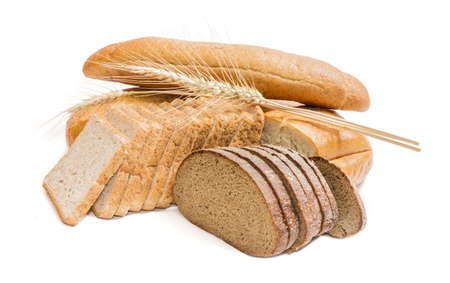 Bread with bran, sliced bread for toasting, wheat bread, sliced brown bread and spikelets of wheat on a light . Isolation Stock Photo