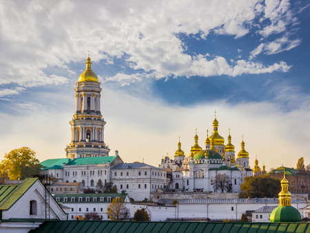 city trip: Kiev-Pechersk Lavra against the sky with clouds autumn. Big Bell tower, Refectory Church and Assumption Cathedral. Kiev, Ukraine