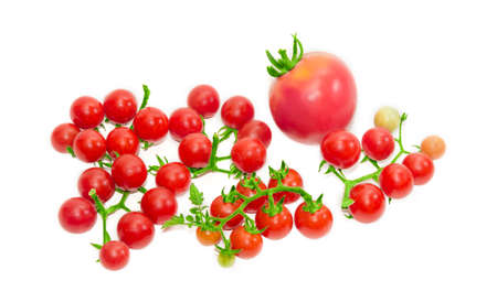 clusters: Several clusters of ripe red cherry tomato and one conventional tomato on a light background. Isolation.