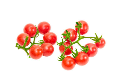 fascicule: Two branches of ripe red cherry tomato on a light background. Isolation.