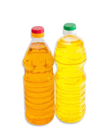sunflower oil: Bottle of unrefined light-amber sunflower oil and bottle of refined pale-yellow sunflower oil on a light background. Isolation.
