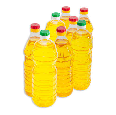 sunflower oil: Several bottles of unrefined and refined sunflower oil on a light background. Isolation.