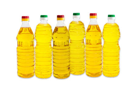 unrefined: Several bottles of unrefined and refined sunflower oil on a light background. Isolation.