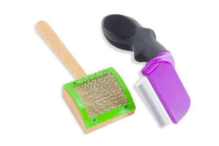 prongs: Wooden comb for cats with curved metal prongs with drops on the ends and comb for combing out the undercoat on a light background. Isolation. Stock Photo