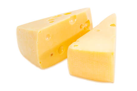 Two pieces of radamer cheese on a light background. Isolation. Stock Photo