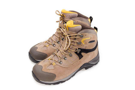 watertight: Mens light brown leather trekking boots on a light background. Isolation. Stock Photo