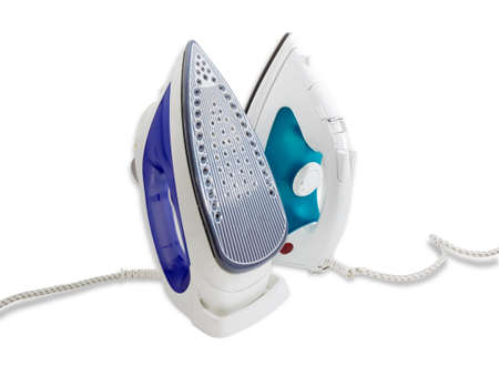 resistive: Two modern electric steam iron on a dark background. Isolation.