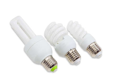 tubular: Three compact energy-saving fluorescent electric light bulb tubular type with tubes different shapes and sizes on a light background.