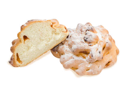 doughy: One whole and a half of a buns with jam sprinkle with powdered sugar on a light background. Stock Photo