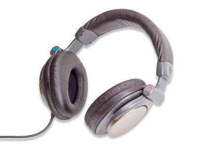 noise isolation: Light brown full size headphones with soft headband on a light background.