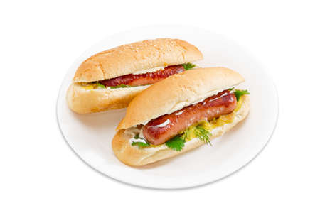 sesame street: Two hot dog with grilled frankfurter, cheese and mayonnaise in bun with sesame seeds on a white dish on a light background.