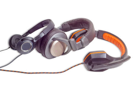 noise isolation: Black supra-aural headphones, light brown full size headphones with soft headband and headset with circumaural headphones and black and orange headband on a light background. Isolation.