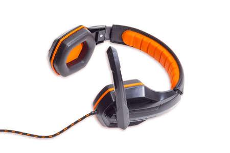 noise isolation: Headset with circumaural headphones and black and orange headband on a light background. Isolation. Stock Photo
