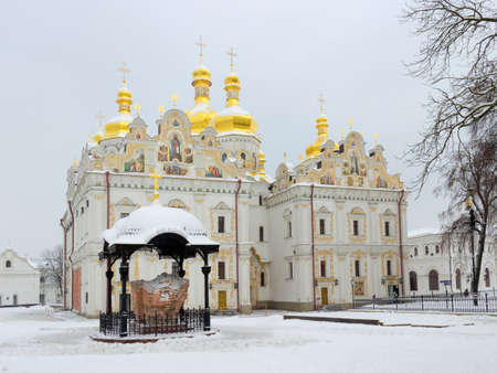 cloudy day: Cathedral of the Dormition in Kyiv Pechersk Lavra winter on a cloudy day. National Historic Cultural Sanctuary,  Kiev, Ukraine.